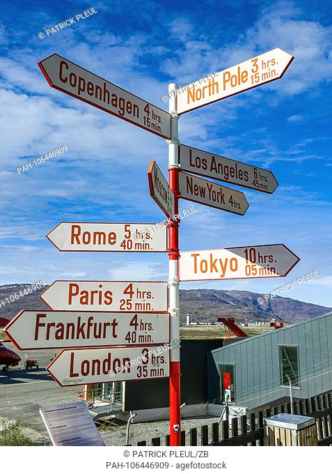 18.06.2018, Gronland, Denmark: A signpost to various capitals in the world stands at the airport of the coastal town of Ilulissat in western Greenland