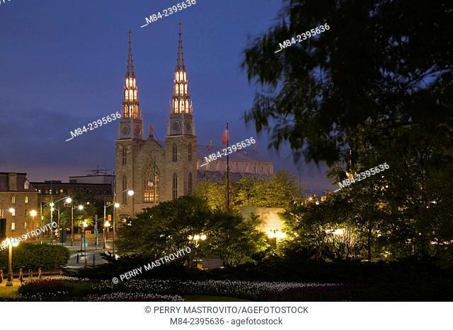 Notre-Dame basilica through Major's Hill park illuminated at dusk, Ottawa, Ontario, Canada