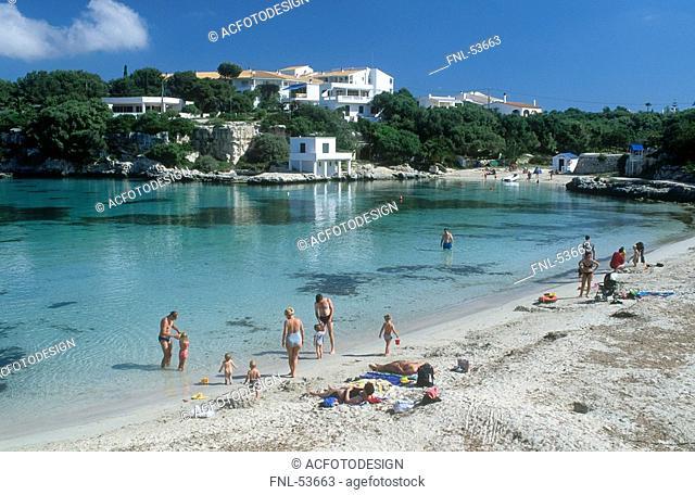 Tourists on beach, Minorca, Balearic Islands, Spain