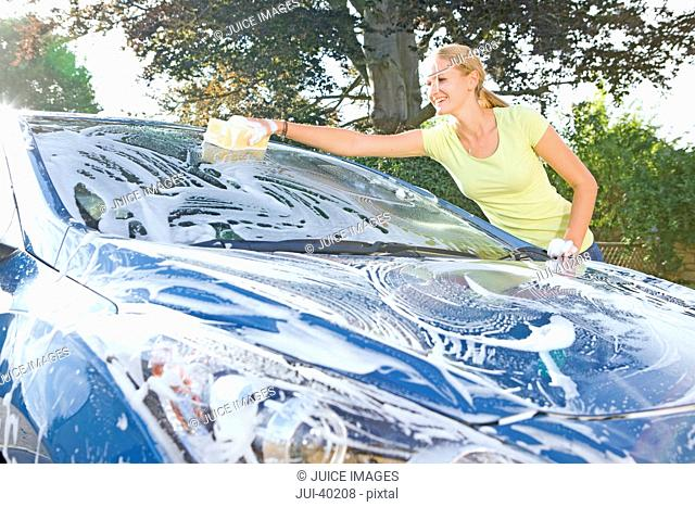 Woman Cleaning Car At Home