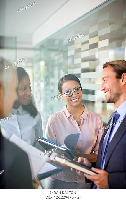 Business people talking in office building