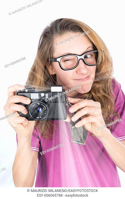 Young nerd photographer with camera in hand which make a flash