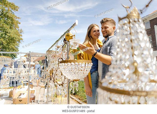 Belgium, Tongeren, smiling young couple on an antique flea market