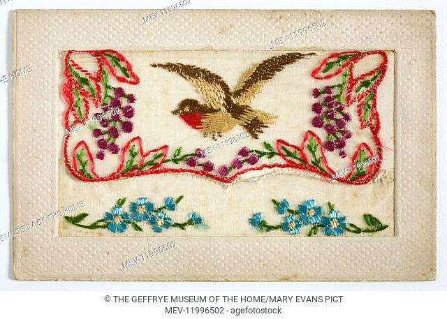 Christmas postcard with an embroidered design in cotton on muslin of a robin, berries, foliage and forget-me-nots within an embossed paper frame