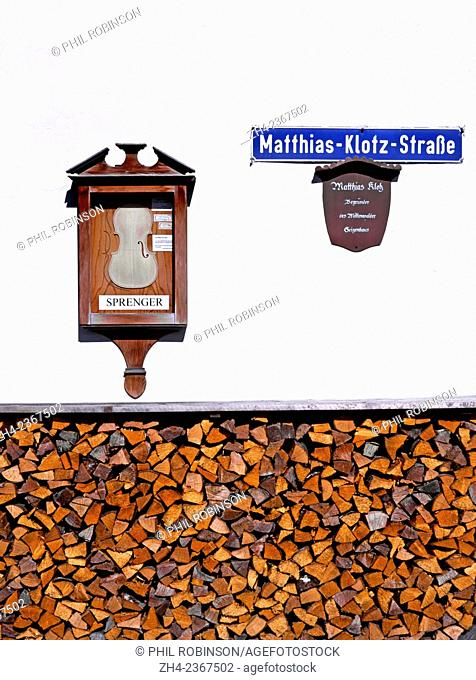Mittenwald, Bavaria, Germany. Wood store and display of violin maker in Matthias Klotz Strasse - street named after the founder of the Mittenwald violin making...
