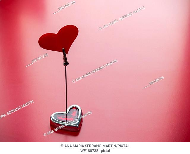 Concept of love A stand with a red heart and red background
