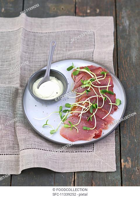 Smoked tuna with a horseradish and dill sauce and sunflower shoots