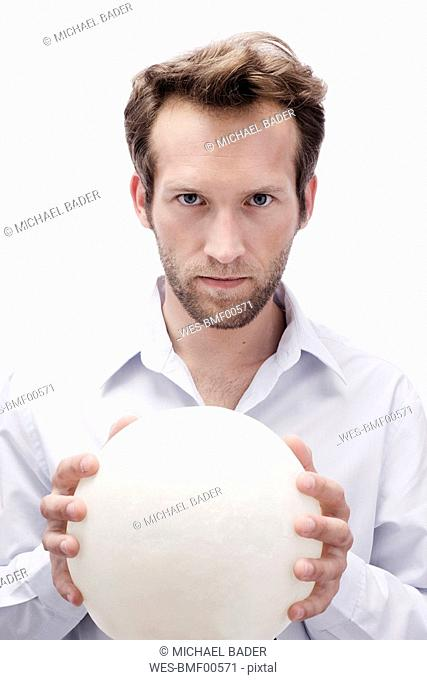Young man with crystal ball, portrait