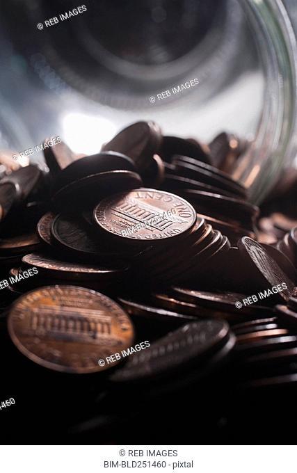 Pile of pennies near jar