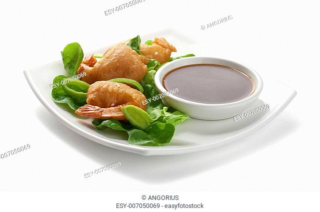 Shrimp tempura with lettuce, leek and soy sauce on the white palate