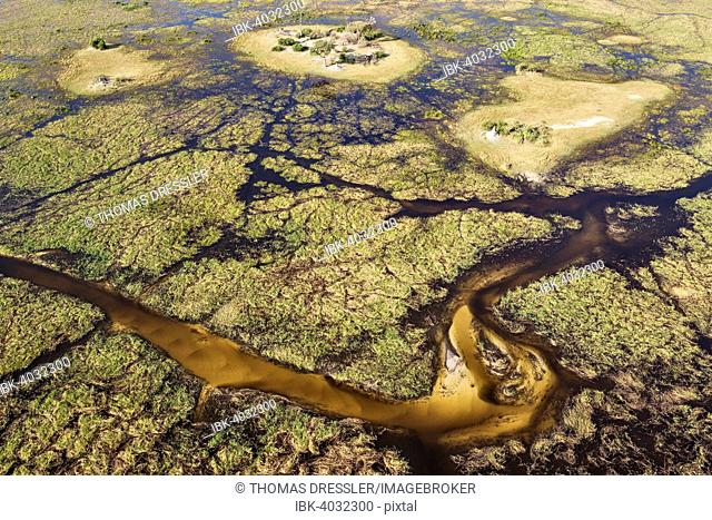 Typical landscape of freshwater marshes with sandy streams, channels and islands, aerial view, Okavango Delta, Botswana