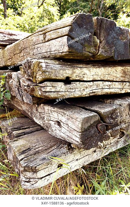 A pile of old, used, wooden railway sleepers