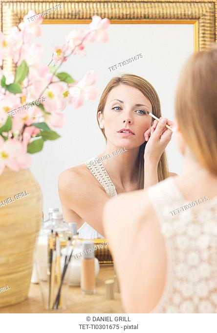Young woman in front of mirror