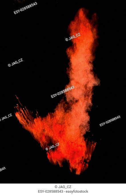 Freeze motion of red dust explosion isolated on black background