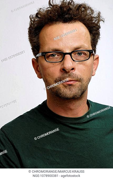 Man with glasses, forty years of age