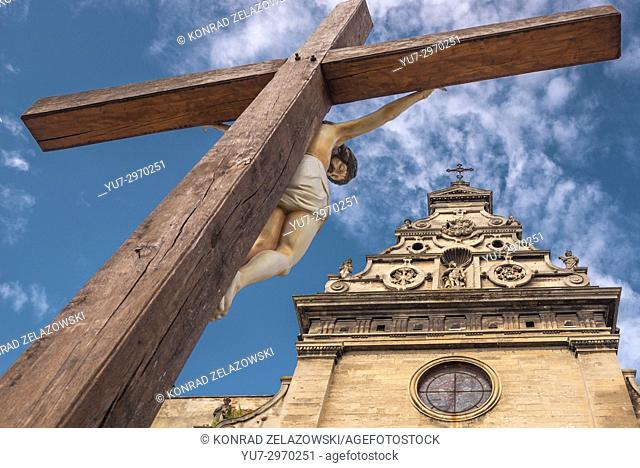Wooden cross in front of Saint Andrew Church of former Bernardine monastery on the Old Town of Lviv city, largest city in western Ukraine