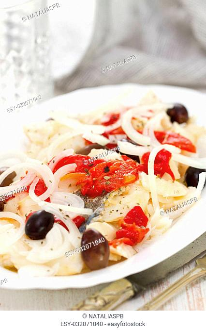 codfish with red pepper and olives on dish