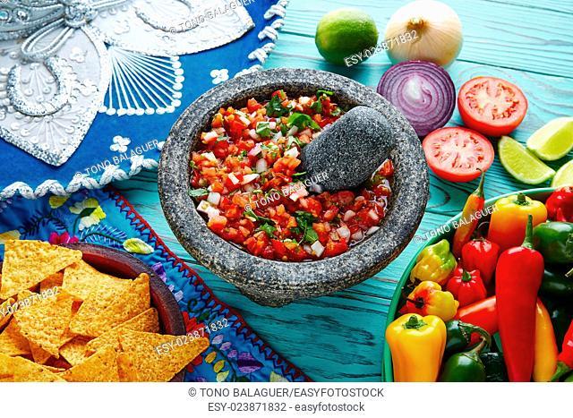 Pico de Gallo sauce from Mexico with tomato cilantro and onion in molcajete