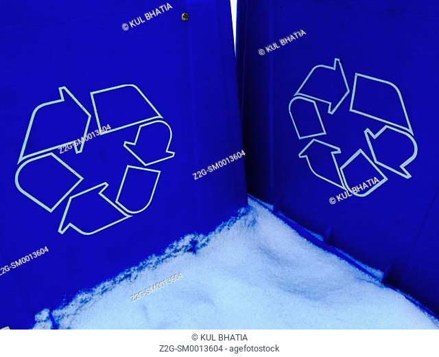 Two recycling blue bins in snow, Ontario, Canada