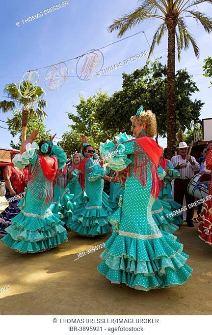 Women wearing gypsy dresses perform traditional Andalusian dances at the Feria del Caballo, Jerez de la Frontera, Cádiz province, Andalusia, Spain