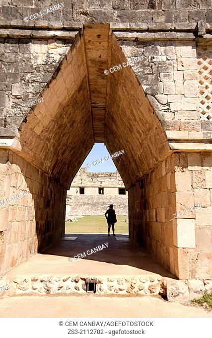 Silhouette of a tourist at a gateway in Uxmal ruins, Prehispanic Mayan city of Uxmal Archaeological Site, Yucatan Province, Mexico, North America