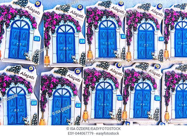 Many ceramic souvenirs representing popular Alacati blue doors and flowers in Izmir,Turkey