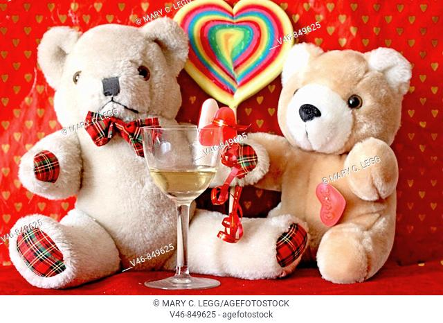 Erasmus and Red Panda Bear celebrate Valentines Day Two teddy bears find themselves alone in the Lonely Hearts Club with only one glass of wine between them