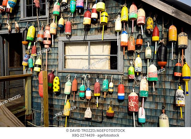 Bouys, lost and found hang on a fishing shack in Bernard, Maine