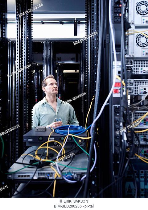 Caucasian businessman working in server room