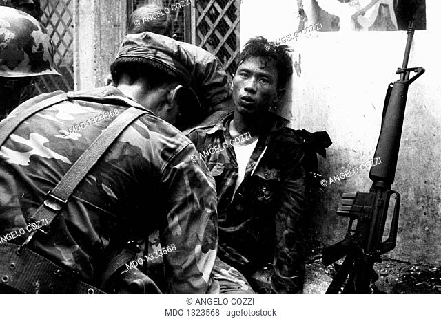 A soldier injured in battle being given aid. A young Vietnamese soldier being tended to after being injured in battle. Saigon (Vietnam), 1968
