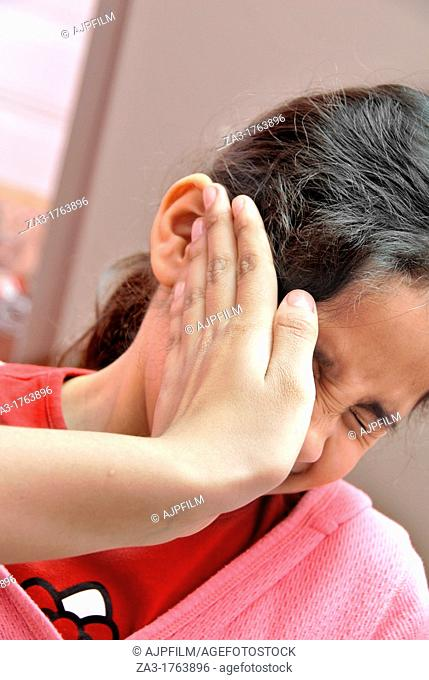Child abuse  Young girl being slapped on the side of her head