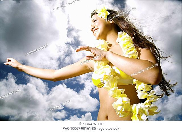 Hawaii, Kauai, Kealia, Beautiful Hawaiian girl dancing hula on ocean shoreline