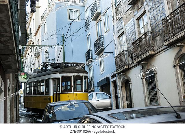 Tram negotiating the narrow, cobblestone streets of Lisbon's Alfama district. Lisbon, Portugal, Europe
