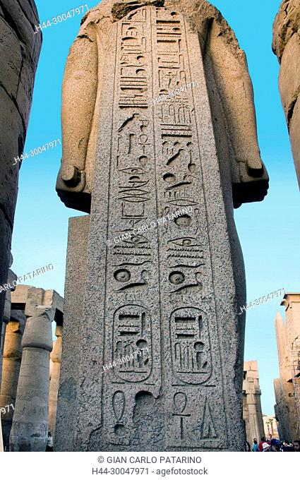 Luxor, Egypt. Temple of Luxor (Ipet resyt): the back of a giant statue of the pharaoh Usermaatra Setepenra Ramses II (1303-1212 b.C.)