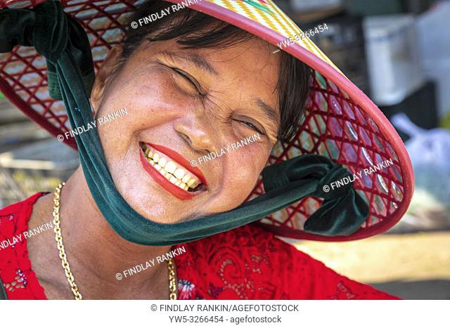 Middle aged Vietnamese woman wearing a traditional sampan hat, Hoi An, Quang Nam Provence, Vietnam, Asia