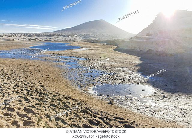 Sand dunes and tabibas in El Medano beach. Montaña Roja on the background. Tenerife island