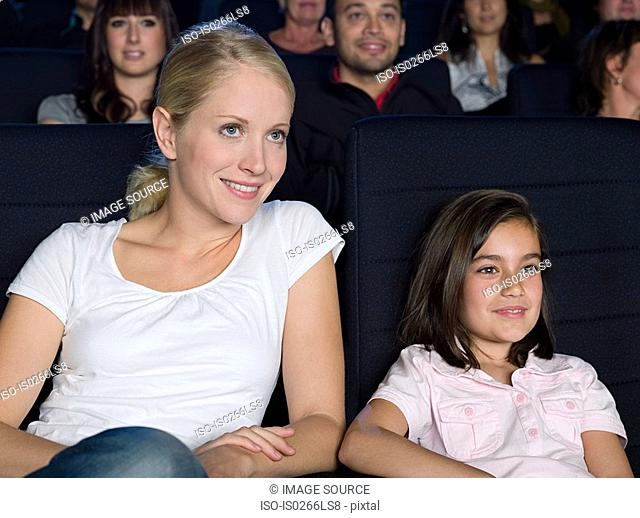 Mother and daughter watching a movie