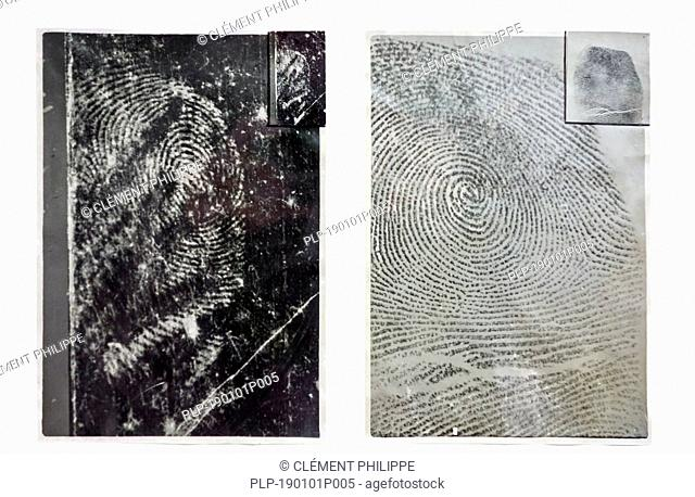 Fingerprint taken from murder weapon at crime scene compared to finger print of suspect recorded with ink on paper for comparison and identification