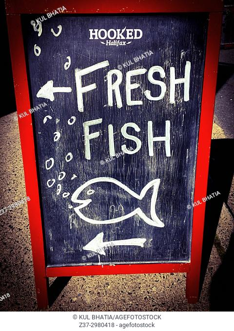 A handwritten sign on a chalkboard for a fish monger selling fresh fish, Halifax, Canada
