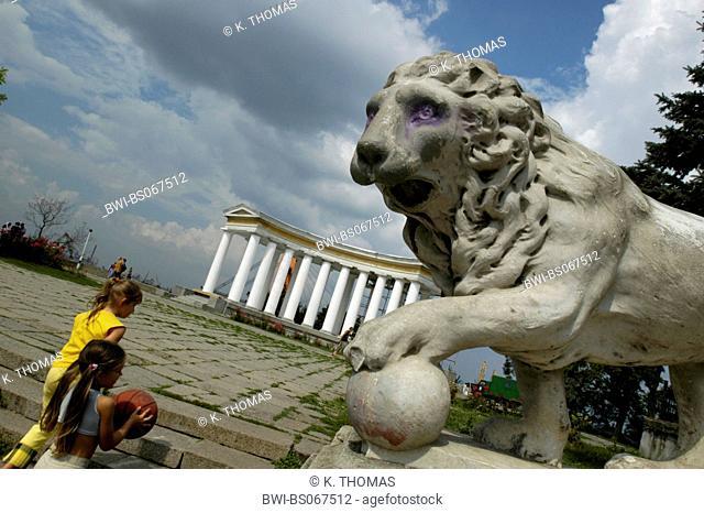 Odessa, Prymorsky bulvar, palace, lion statue with ball, children with ball, Ukraine, Southern Ukraine, Odessa