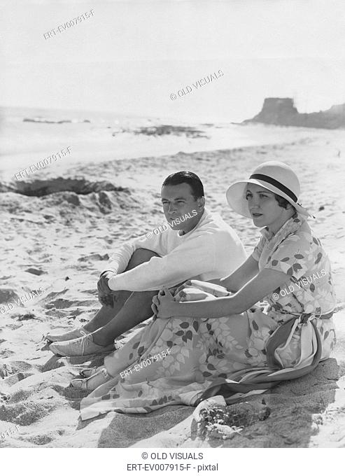 Couple relaxes at the beach