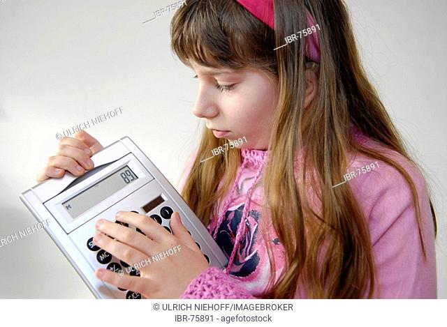 Girl with pocket calculator