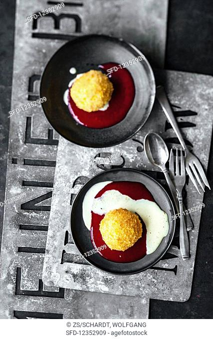 Deep-fried vanilla ice cream with raspberry coulis