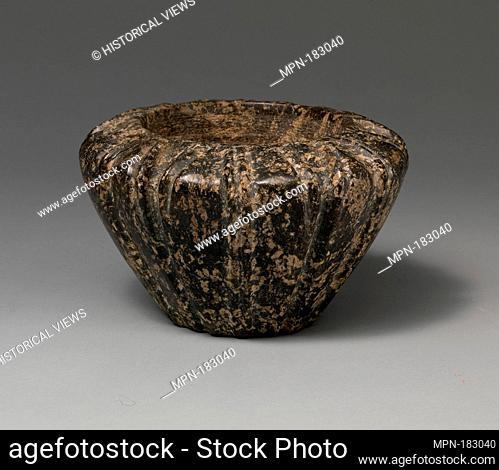 Serpentine blossom bowl. Period: Late Minoan I; Date: ca. 1600-1450 B.C; Culture: Minoan; Medium: Serpentine; Dimensions: H. 4 1/4 in. (10