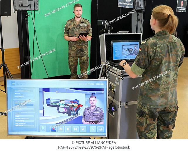 24 July 2018, Germany, Leipzig: Two soldiers shoot a training video for the P8 pistol in a mobile studio. The German Minister of Defence von der Leyen of the...