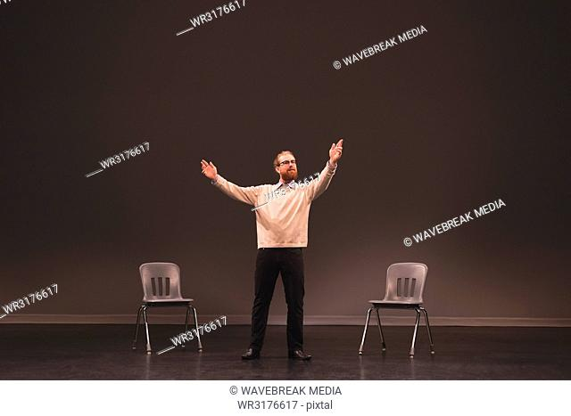 Male actor rehearsing on stage