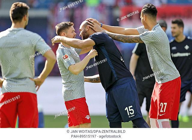 Leipzig's Spieler Dominik Kaiser (l) and Davie Selke (r) greeting Ex-Leipziger and Darmstadt's Terrence Boyd (M) before the German Bundesliga soccer match...