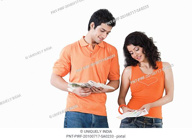 Couple choosing color from color swatches for their house