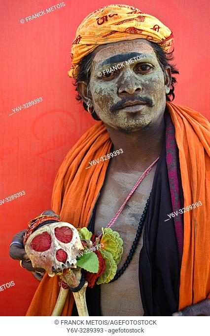 """Hindu ascetic (""""""""sadhu"""""""") belonging to the Aghori sect ( Allahabad, India). He is showing the skull of a monkey. Aghori sadhu are known for performing post..."""