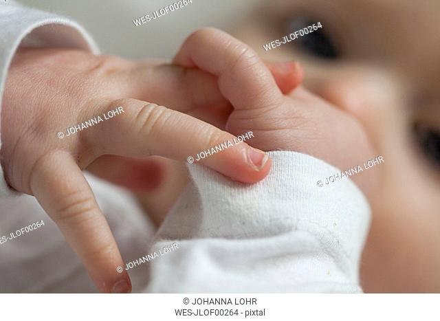Fingers of baby girl, close-up